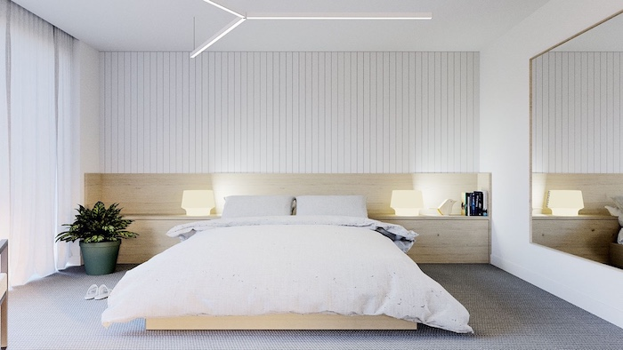 over the bed decor, white walls, wooden bed frame and shelves, large grey carpet, large mirror