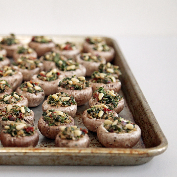 mushrooms filled with quinoa and nuts, easy vegetarian appetizers, in a metal tray