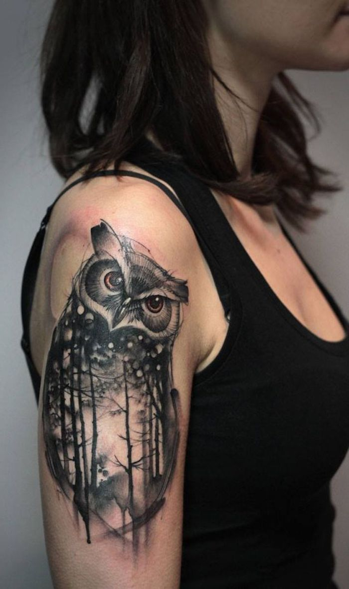 owl and forest, shoulder tattoo, tattoo ideas for women, woman with black hair, wearing black top