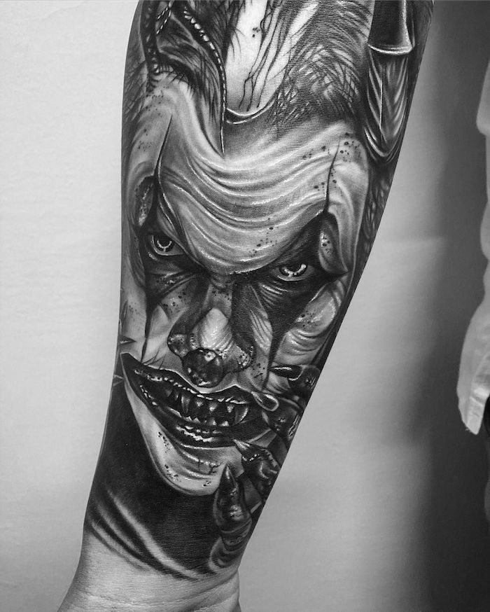 pennywise the dancing clown, forearm tattoo, tattoo ideas for guys, white background