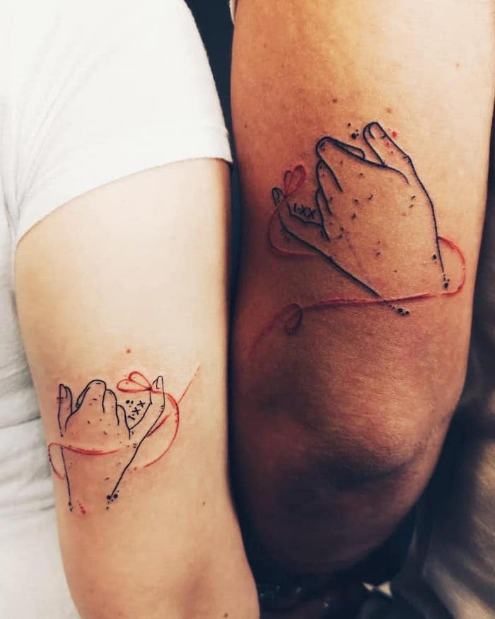 pinky swear, couple finger tattoos, back of arm tattoos, red heart string