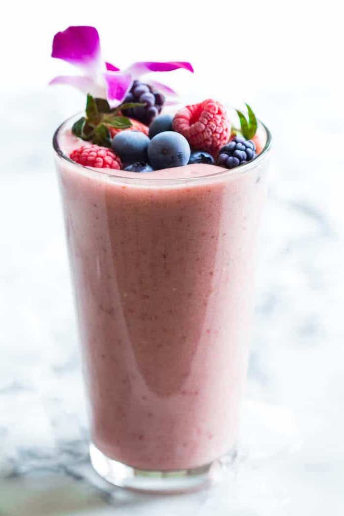 how do you make a smoothie, different berries on top, purple flower