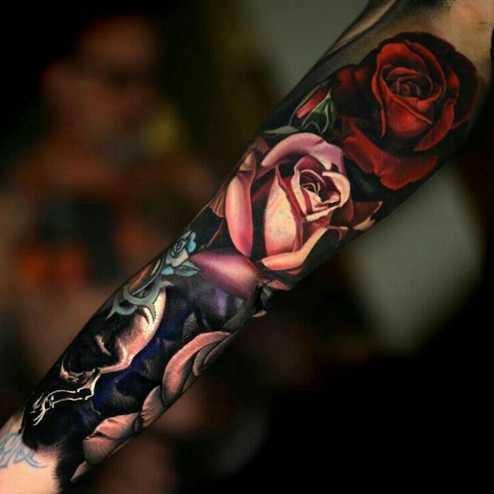 meaningful tattoos, pink and red roses, arm sleeve tattoo