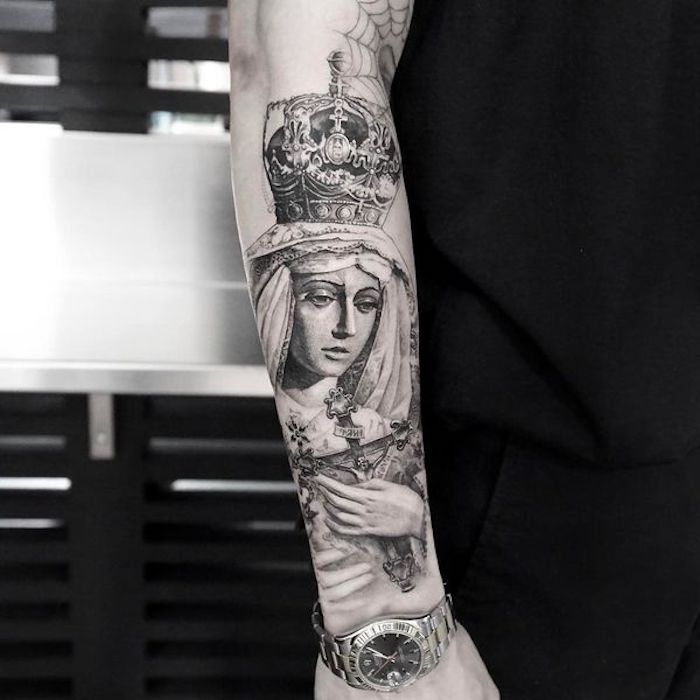 religious theme, woman holding a cross, tattoo ideas for men arm, black shirt