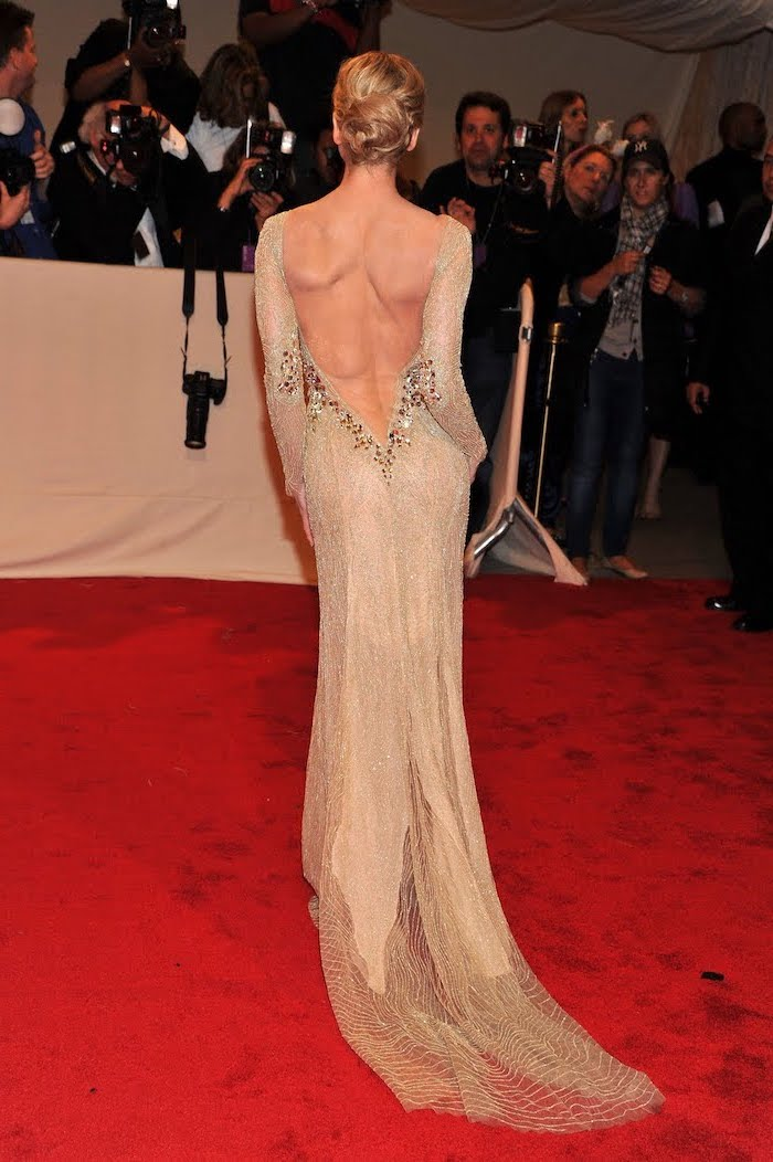 long nude dress, with bare back, renee zellwegger, costume institute, on the red carpet