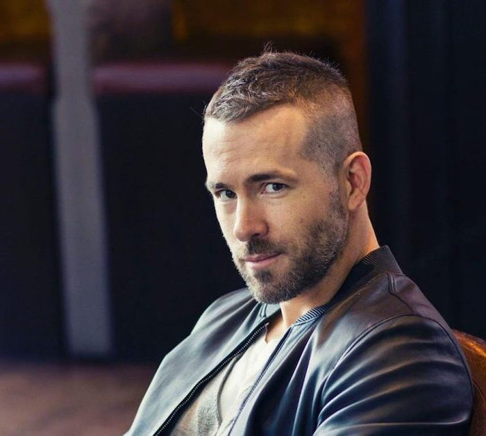 ryan reynolds, wearing a leather jacket, short brown hair, hairstyles for men
