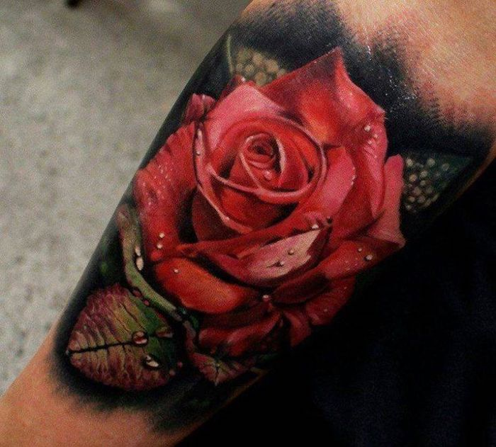 large red rose, covered in raindrops, forearm tattoo, tattoos for girls on hand