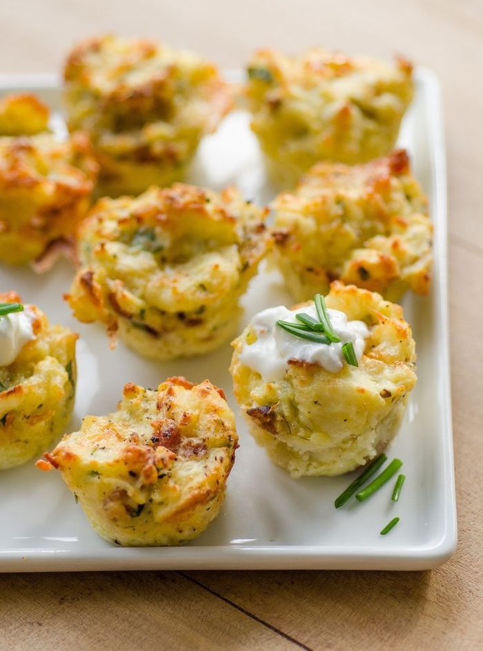 potato bites, with sour cream and chives, vegan superbowl snacks, in a white plate