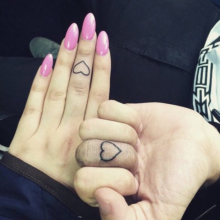 heart outlines, finger tattoos, his and hers matching tattoos, long pink nails