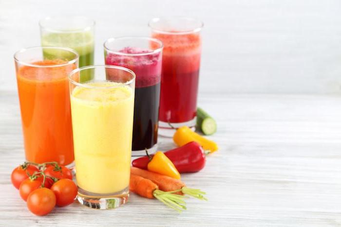different vegetable smoothies, in tall glasses, peanut butter and banana smoothie, cherry tomatoes, peppers and carrots