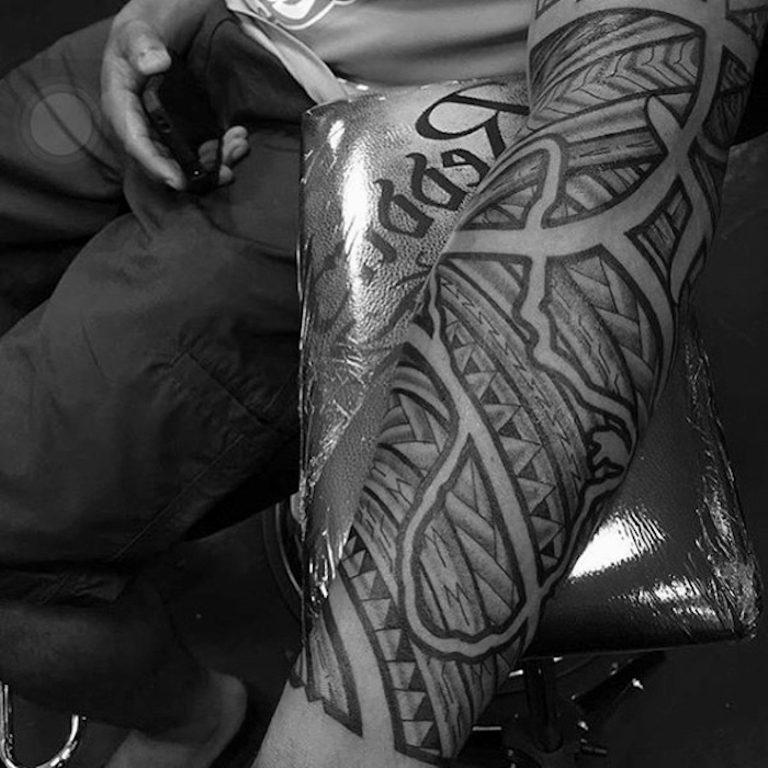 small tattoos for guys, tribal forearm sleeve, cargo pants, grey shirt