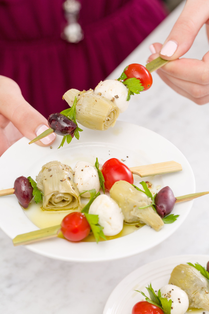 veggie pinwheels, olives and onion, mozzarella and cherry tomatoes, on a wooden skewer