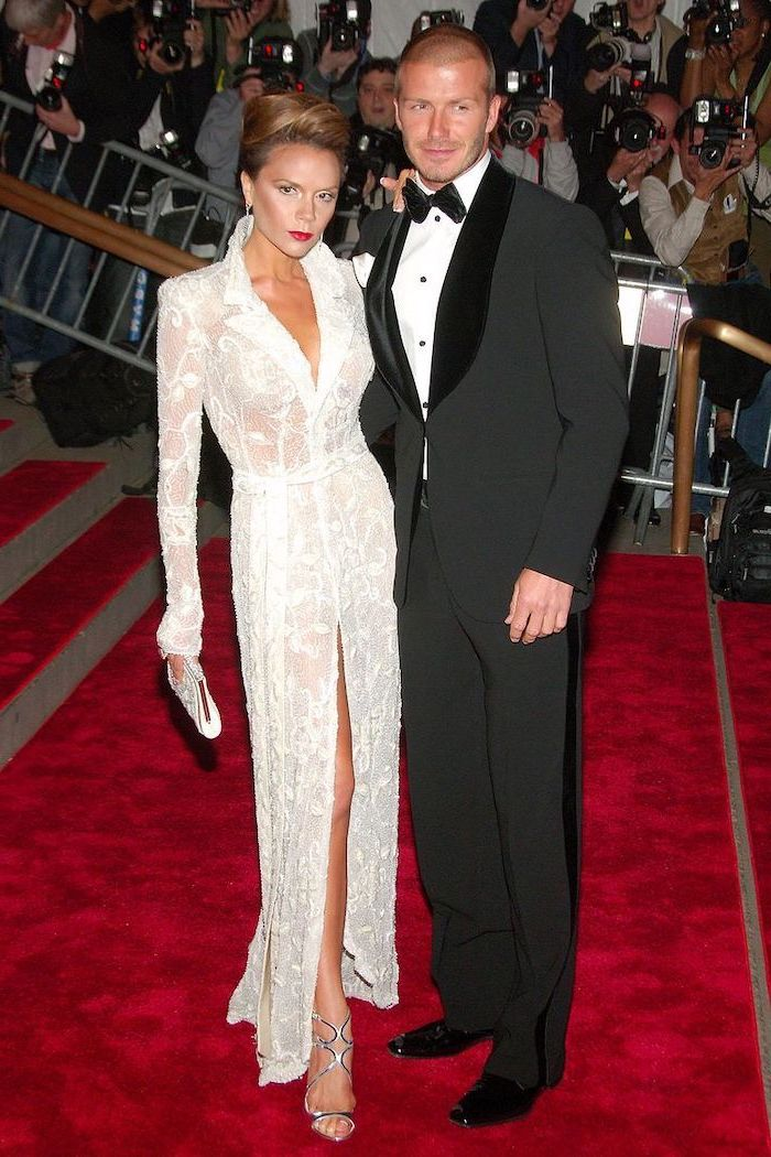victoria beckham, long white dress, david beckham, wearing a tuxedo, met costume institute