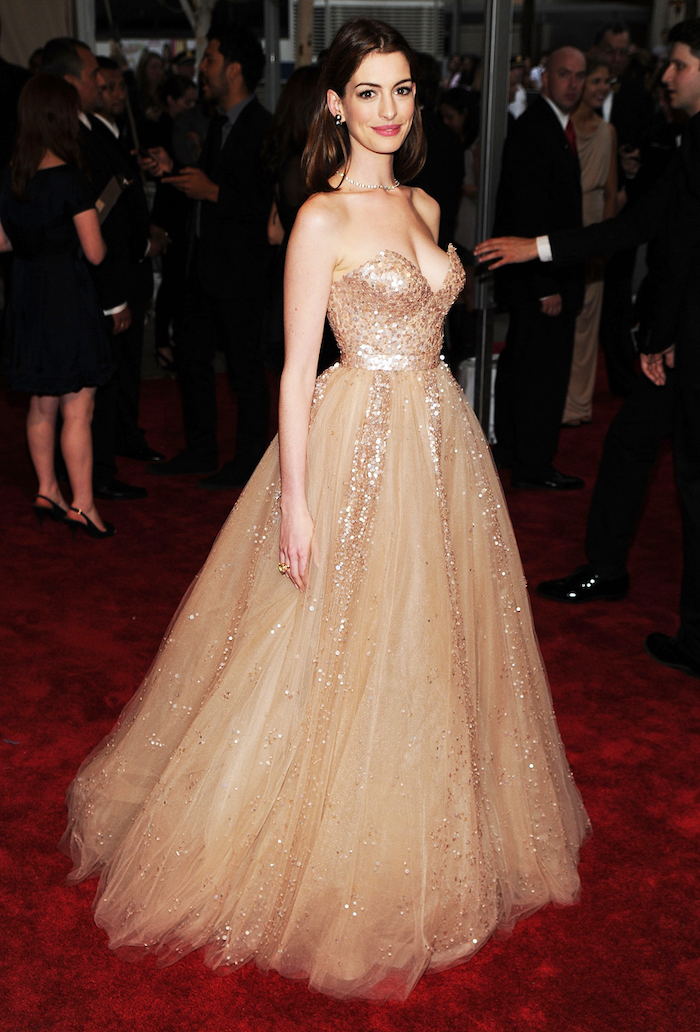 gold sequinned dress, with tulle, anne hathaway, what is the met gala, long brown hair