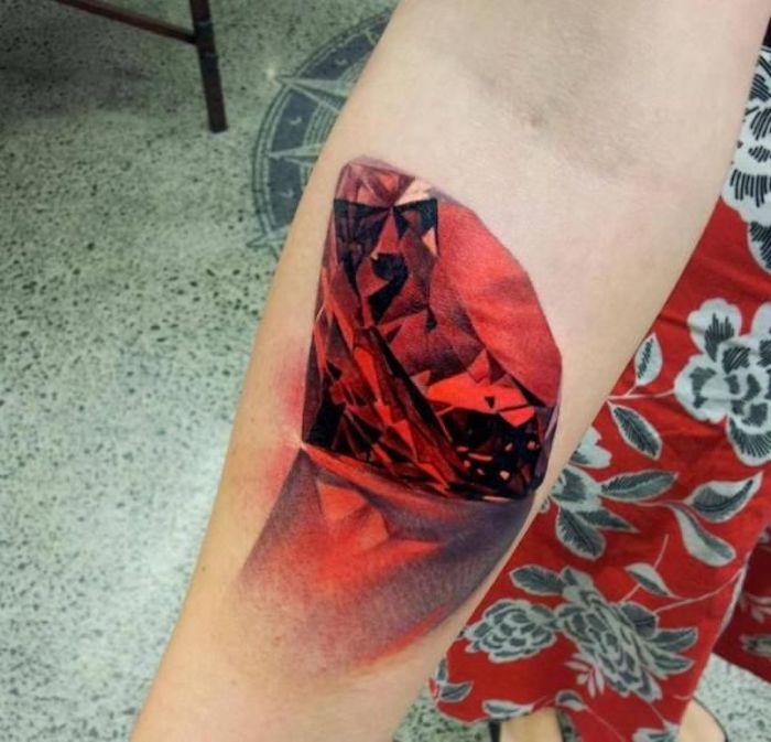 what tattoo should i get, large red diamond, forearm tattoo, red skirt