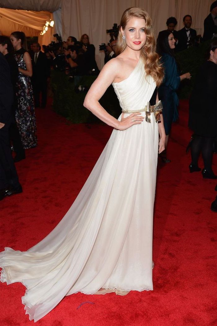 amy adams, long red hair, long white dress, gold bow in the middle, met costume institute