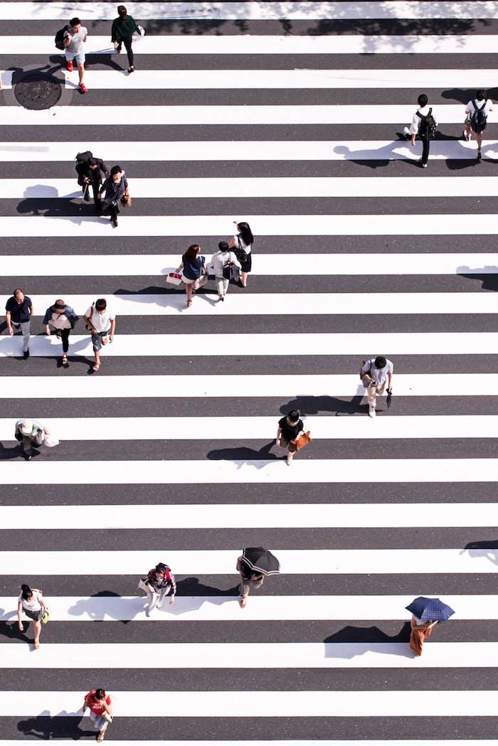 large crossing, people walking along, grey white stripes, tumblr backgrounds black and white