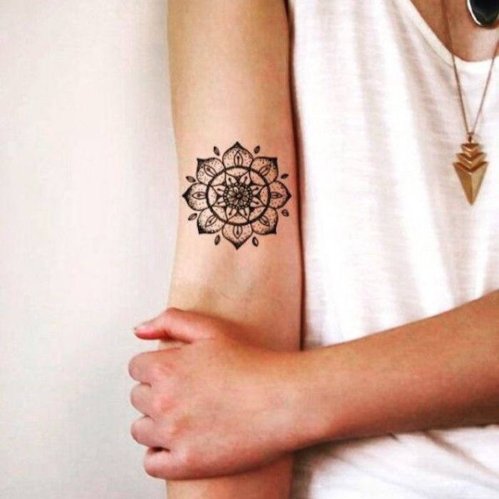 female tattoos gallery, mandala tattoo, inside arm tattoo, white top, gold necklaces