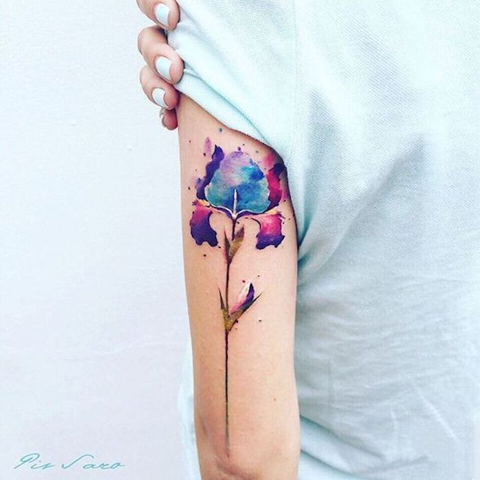 tattoos with deep meaning, watercolour flower, back of arm tattoo, white top