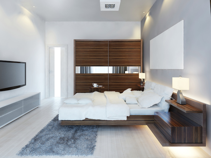 wooden wardrobe, grey accent wall, white walls, master bedroom wall decor, grey carpet, floating bed frame