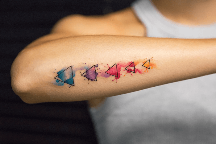 five triangles, back of arm, watercolor butterfly tattoo, white top
