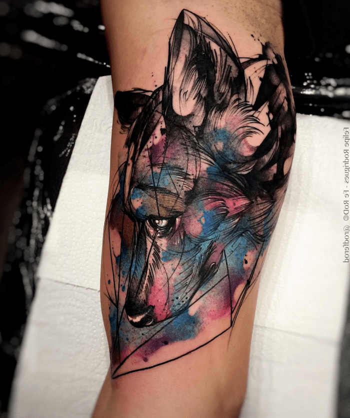 wolf head, inside arm tattoo, small watercolor tattoo, white paper