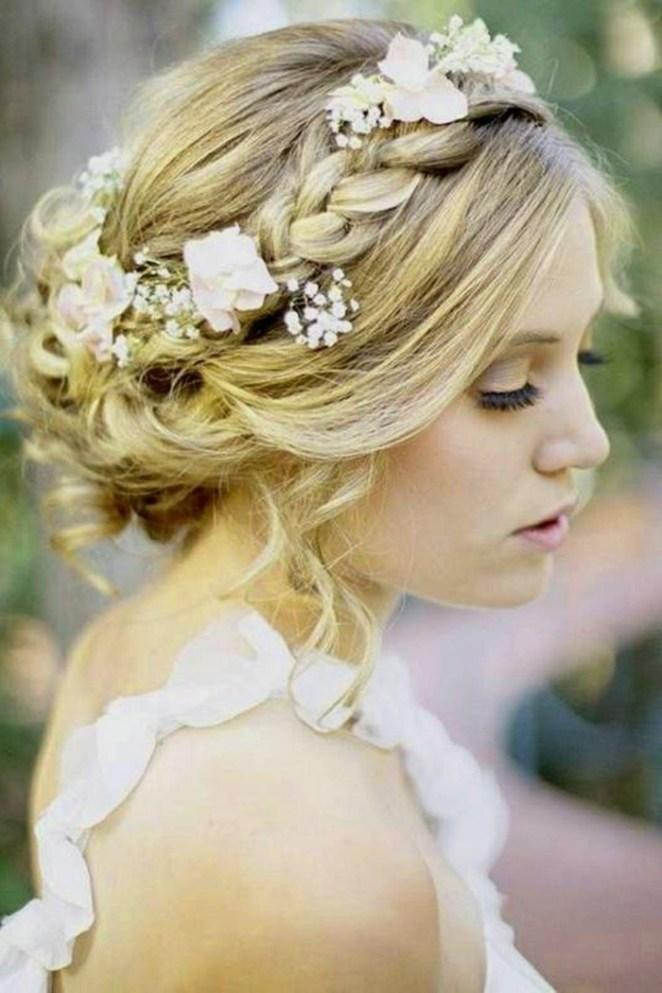 Updos for long hair, a blonde bride, flowers in her hair, braid like crown