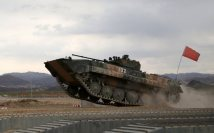 A Chinese Type-86A armored infantry fighting vehicle (IFV) moves on a mock treadway bridge obstacle in high speed during a driving skills training exercise at a military training base in Korla of northwest China's Xinjiang Uygur Autonomous Region on July 20, 2017. It will participate in the upcoming Suvorov Attack event of the International Army Games (IAG) 2017. (eng.chinamil.com.cn/Photo by Luo Xingcang and Zhao Zhiguo)