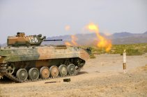 A Chinese armored infantry fighting vehicle (IFV) spites fire as it sends a shell down range during a live-fire training exercise at a military training base in Korla of northwest China's Xinjiang Uygur Autonomous Region on July 20, 2017. It will participate in the upcoming Suvorov Attack event of the International Army Games (IAG) 2017. (eng.chinamil.com.cn/Photo by Luo Xingcang and Zhao Zhiguo)