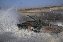 A Type-86A armored infantry fighting vehicle (IFV) wades through a mock ford during a driving skills training exercise at a military training base in Korla of northwest China's Xinjiang Uygur Autonomous Region on July 20, 2017. It will participate in the upcoming Suvorov Attack event of the International Army Games (IAG) 2017. (eng.chinamil.com.cn/Photo by Luo Xingcang and Zhao Zhiguo)