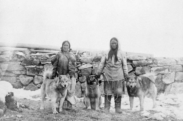 Inuits with dogs in the arctic