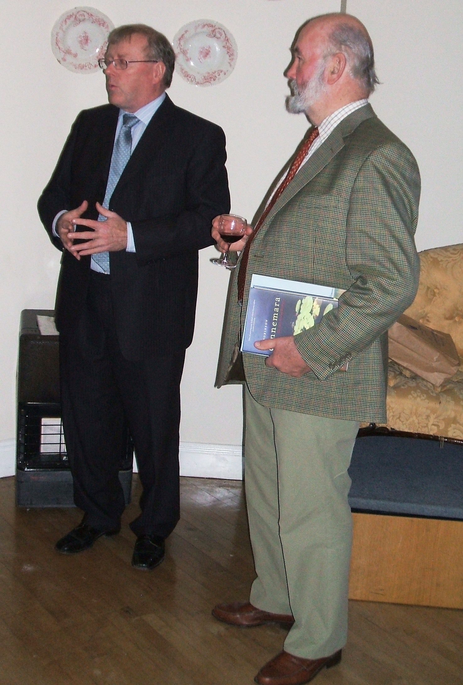 Photographer John Petch received a books as a token of appreciation from society President Dermot Power