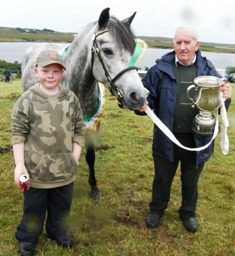 Champion Dooneen Alice with Peter Molloy Snr. and grandson