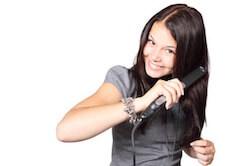 girl straightening hair
