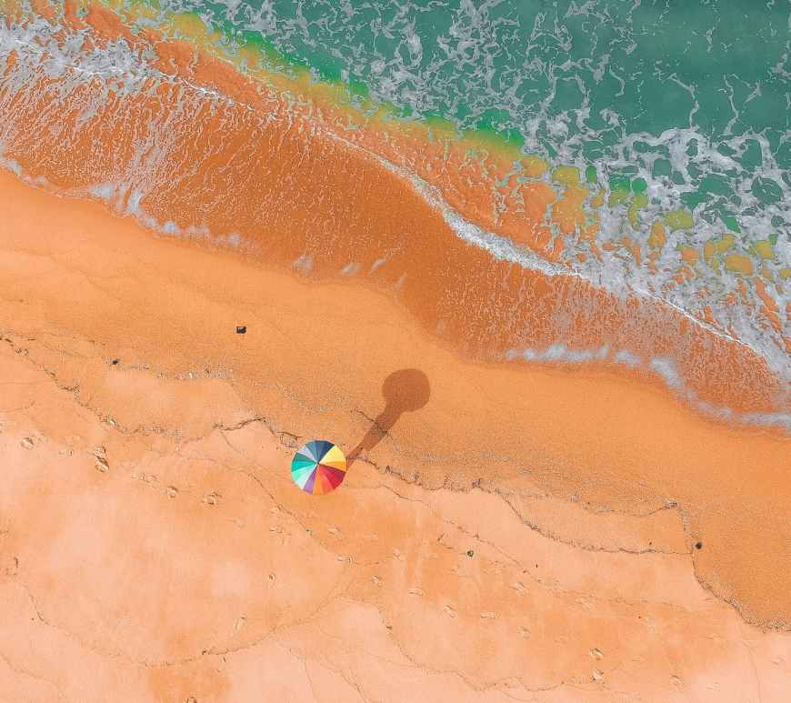 Vacation time: colorful umbrella on beach