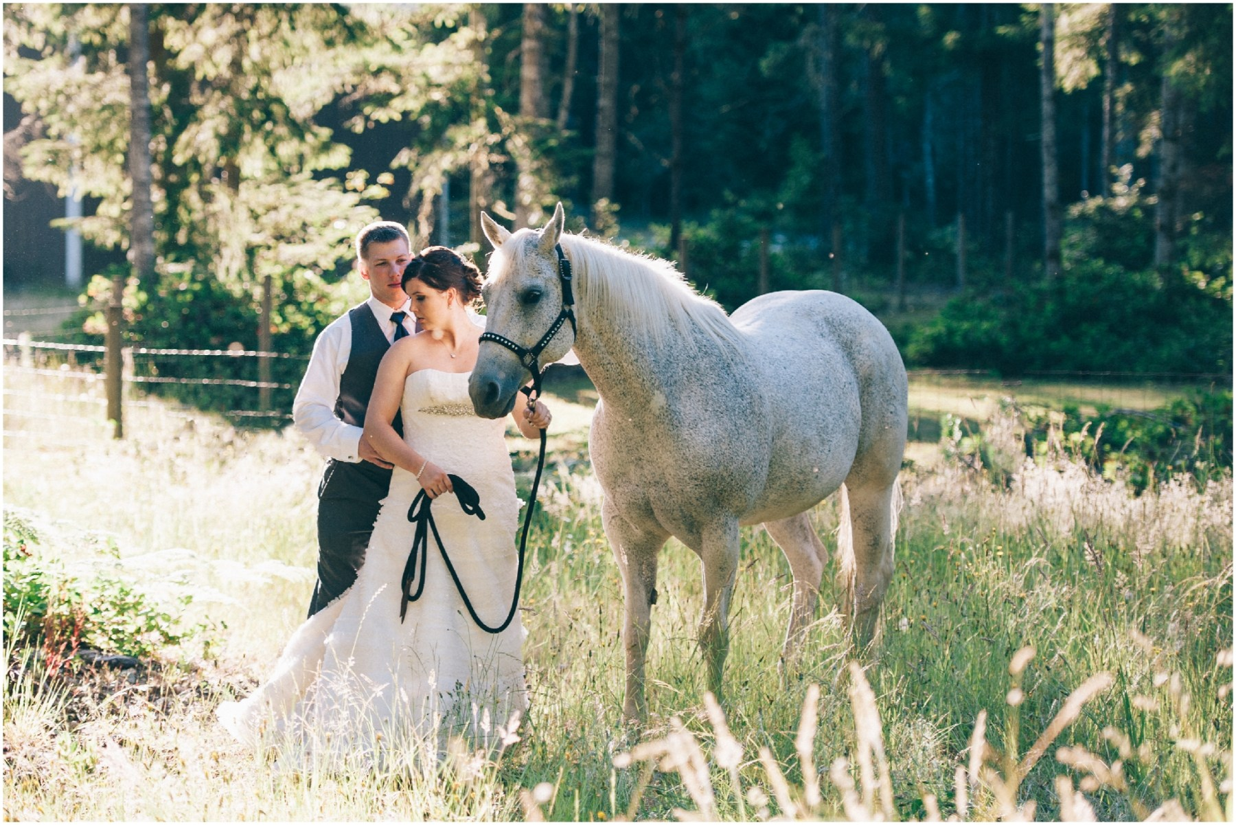 Bride and Groom Wedding Photo standing next to a horse by Ardita Kola Photography