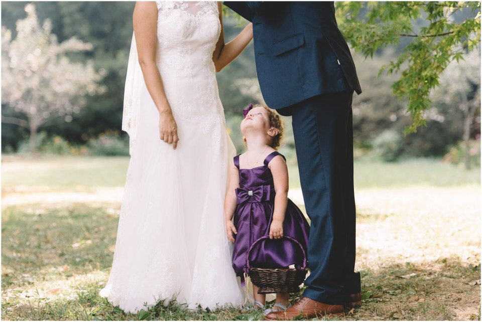 Flower girl photo with bride and groom