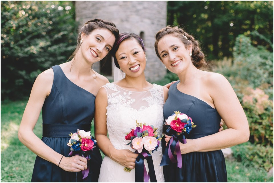 Photo of bride with her bridesmaids laughing
