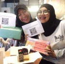 Me and Anggiet with our birthday cakes and gifts