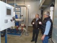 Mayor Rick Berrigan (left) and TNRD Area O Director Bill Kershaw in new plant.