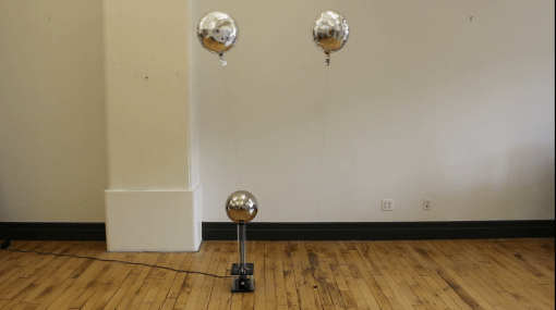 two Mylar balloons: attracted and repelled