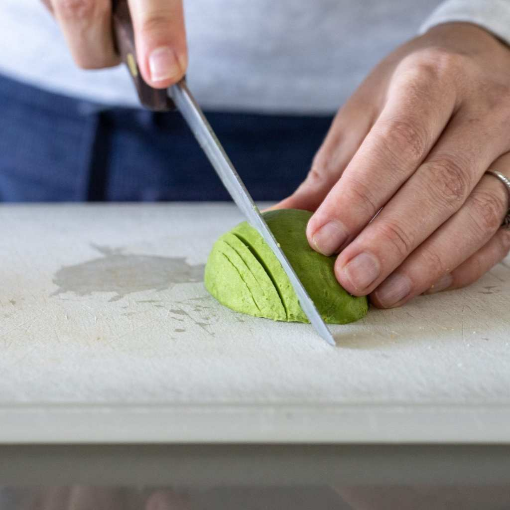 woman slicing an avocado thinly for an avocado rosette