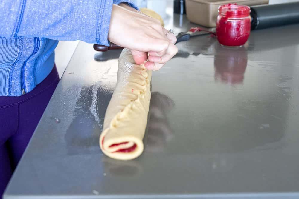 woman pinch raspberry swirl loaf closed
