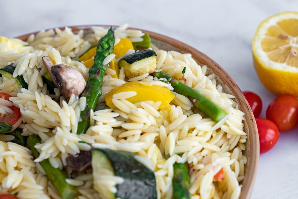 roasted veggie and orzo salad in ceramic bowl