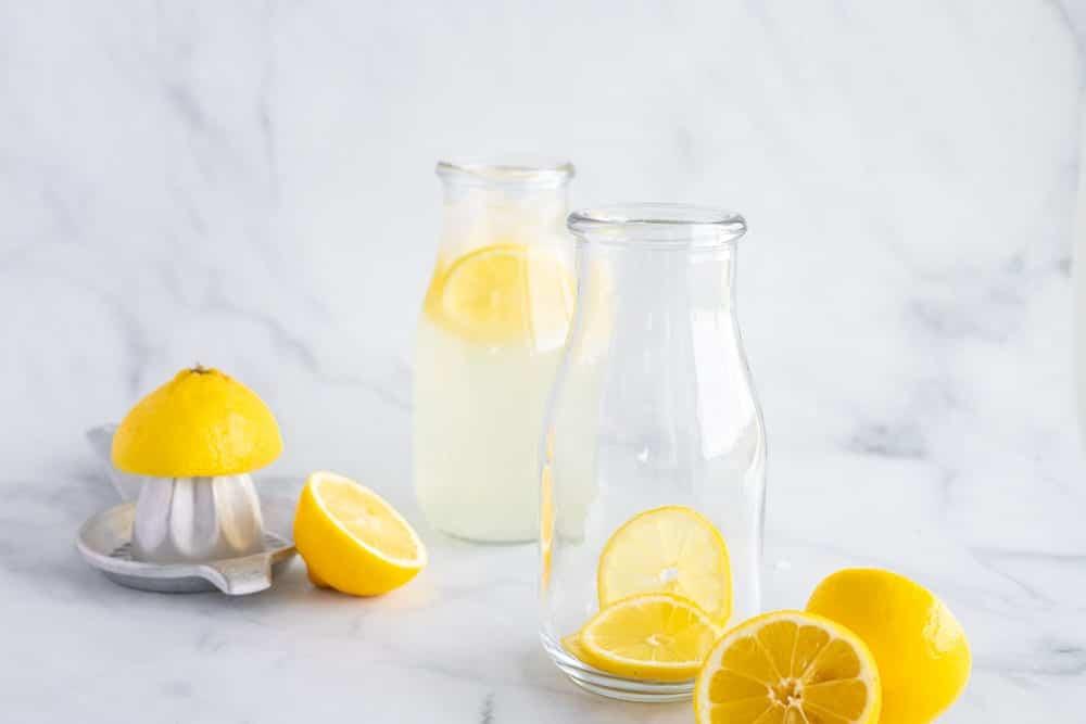 milk glasses filled with lemonade and fresh lemon slices