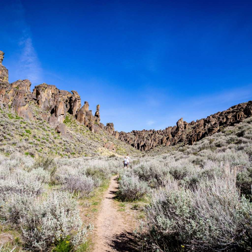 2 boys hiking though canyons