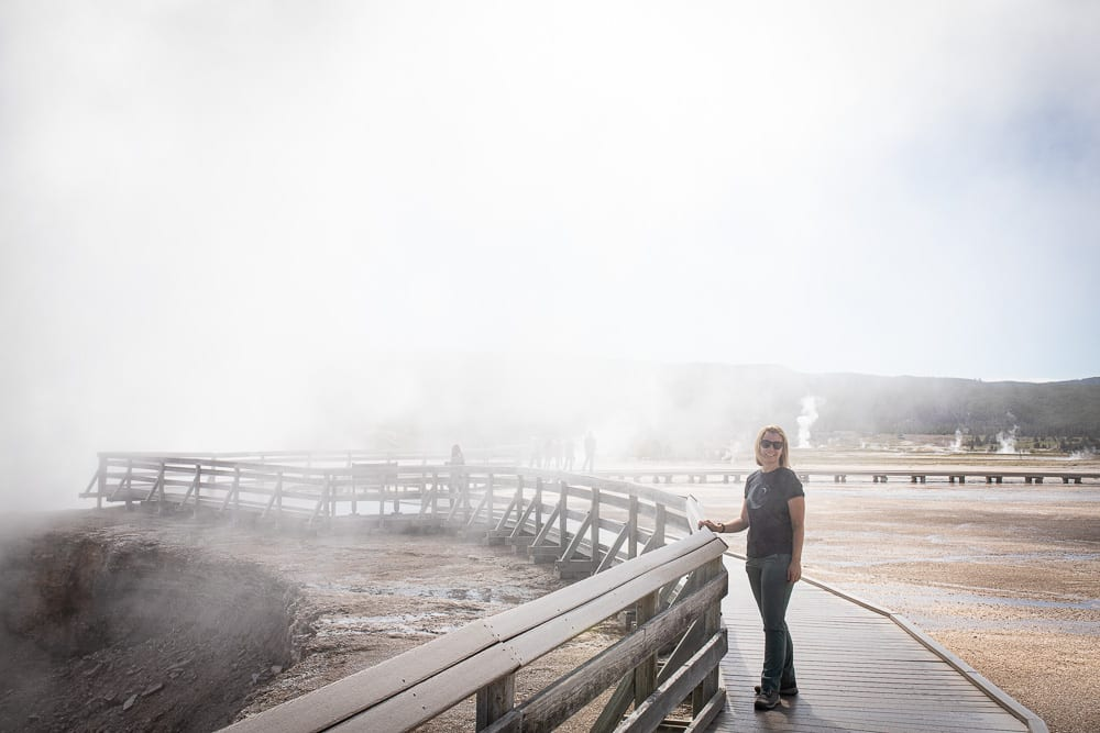 women standing by steaming midway geyser basin