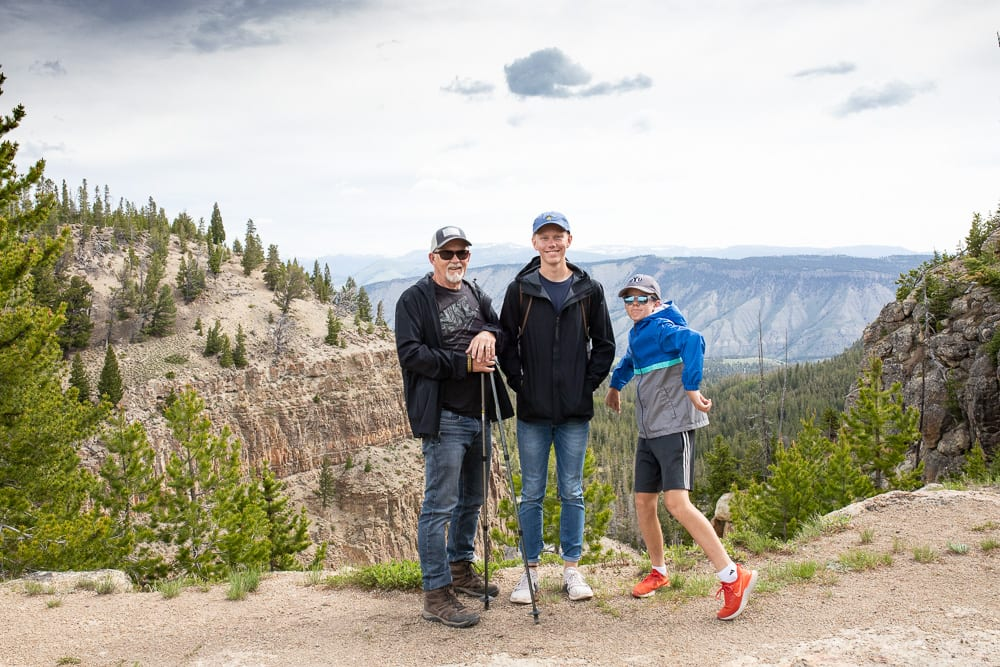 man and 2 sons hiking on Bunsen Peak trail Yellowstone