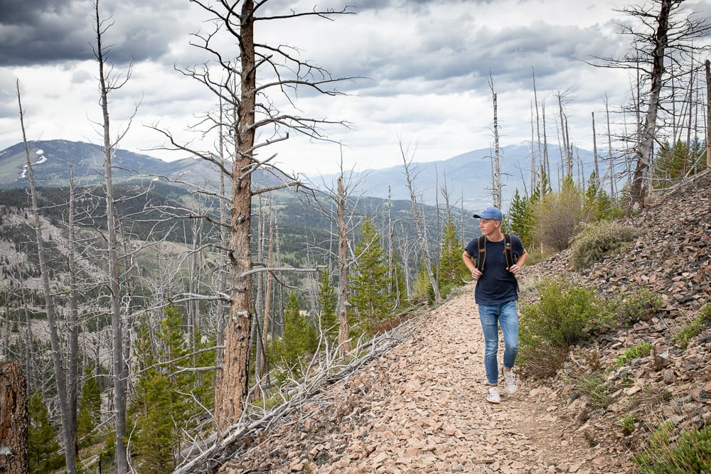 teenage boy with backpack on hiking up Bunsen Peak trail Yellowstone