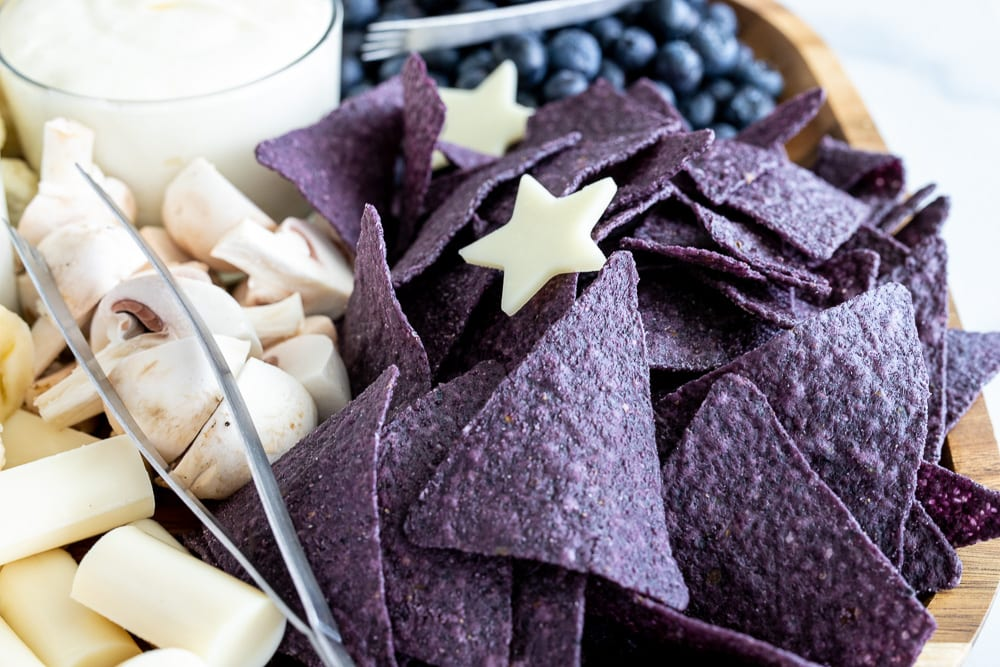 blue corn chips on a fourth of July charcuterie board